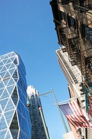 Low angle view of an American flag on a building, New York City, New York State, USA