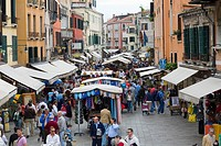 Tourists in a street market, Venice, Italy