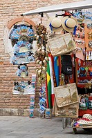 Craft products hanging in a market stall, Venice, Italy