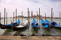 Gondolas docked in a canal, Grand Canal, Venice, Italy