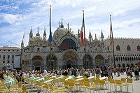 Tourists walking in front of a church, St  Mark's Cathedral, St  Mark's Square, Venice, Italy