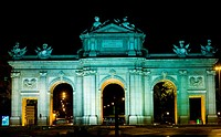 Memorial gate lit up at night, Alcala Gate, Madrid, Spain