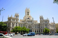 Traffic in front of a government building, Palacio De Comunicaciones, Plaza de Cibeles, Madrid, Spain