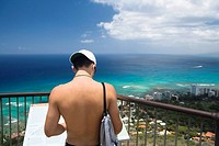 Rear view of a man standing at an observation point, Diamond Head, Waikiki Beach, Honolulu, Oahu, Hawaii Islands, USA