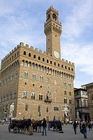 Horse carts in front of a palace, Pallazo Vecchio, Piazza Della Signoria, Florence, Italy
