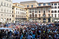 Crowd in front of buildings, Piazza Della Signoria, Florence, Tuscany, Italy