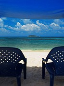 Empty chairs under the tent on the beach, Spratt Bight Beach, San Andres, Providencia y Santa Catalina, San Andres y Providencia Department, Colombia