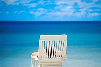 Rear view of a person lying on a lounge chair on the beach, South West Bay, Providencia, Providencia y Santa Catalina, San Andres y Providencia Depart...
