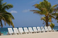 Beach chairs on the beach, Roatan, Bay Islands, Honduras