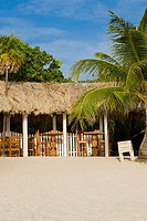 Thatched roof restaurant on the beach, West Bay Beach, Roatan, Bay Islands, Honduras
