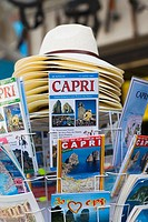 Magazines and sun hats at a market stall, Capri, Campania, Italy