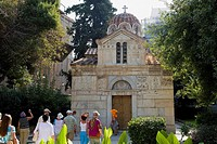 Tourists in front of a church, Panagia Gorgoepikoos, Athens, Greece