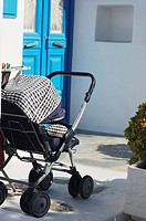 Baby stroller near a potted plant, Mykonos, Cyclades Islands, Greece