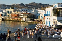 Large group of people standing at the coast, Mykonos, Cyclades Islands, Greece