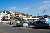 Cars parked at the roadside, Skala, Patmos, Dodecanese Islands, Greece