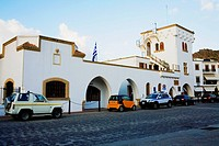 Cars parked in front of a building, Patmos, Dodecanese Islands, Greece