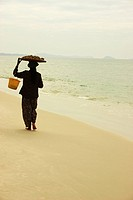 Rear view of a woman walking on the beach, Sihanoukville, Cambodia