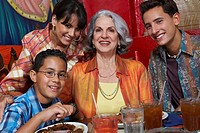 Close-up of a three generation family in a restaurant