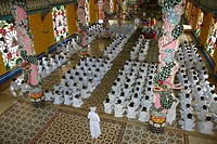 High angle view of a group of people praying in a monastery, Cao Dai Monastery, Tay Ninh, Vietnam