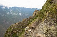High angle view of the old ruins, Aguas Calientes, Mt Huayna Picchu, Machu Picchu, Cusco Region, Peru