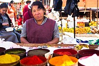 Portrait of a mature woman standing at a market stall, Peru