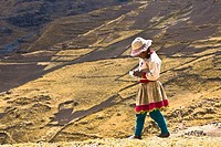 Side profile of a girl walking on a hill, Peru