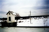 Small roadside chapel in the Ukraine in winter