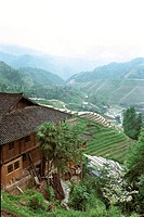 Elevated view of houses and terraced fields on Longji mountain, Longsheng County, Guilin City, Guangxi Zhuang Nationality Autonomous Region of People'...