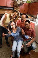 Portrait of African American family in kitchen