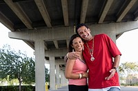 Portrait of a young hip_hop couple under highway overpass