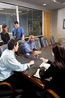 Business colleagues at a working meeting in a conference room