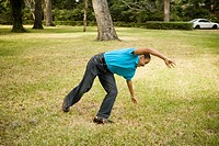 Boy doing cartwheel on the grass