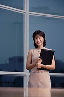 Smiling businesswoman with portfolio