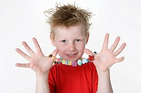 Boy showing a necklace