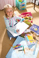 Girl 8-10 drawing in bedroom, smiling, portrait, elevated view