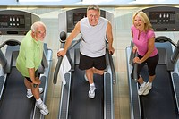 Senior couple and man on treadmills, smiling, portrait, elevated view