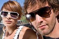 Young couple in sunglasses, portrait, close-up