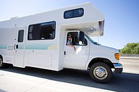 Woman in sunglasses in motor home, side view