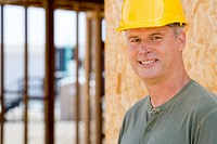 Man in hardhat, smiling, portrait