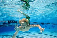 Boy 10-12 in swimming pool, portrait, underwater view