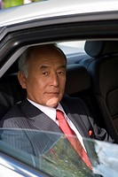 Businessman in car, portrait