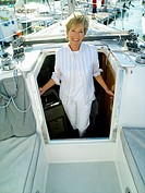 Woman in entrance to cabin of boat, smiling, portrait (thumbnail)