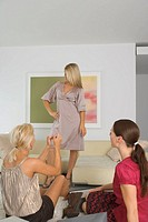 Woman showing her new dress to friends