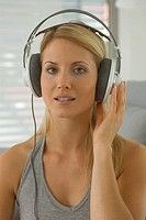Woman wearing earphones