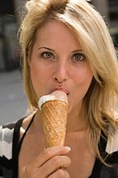 Young woman eating ice cream cone (thumbnail)