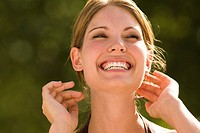 Portrait of happy young woman laughing (thumbnail)
