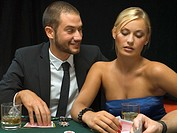 Couple playing poker game