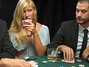Woman holding playing cards in poker game