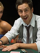 Happy man at poker game (thumbnail)