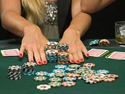 Detail of woman's hands and poker chips (thumbnail)